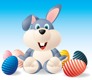Easter bunny. With Easter eggs Stock Photos