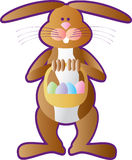 Easter Bunny. A cartoon Easter Bunny holding a basket full of Easter eggs Stock Photography
