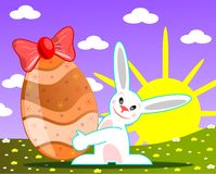Happy Easter bunny in a meadow royalty free stock photography