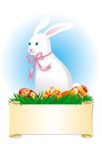 Easter bunny. Cute easter bunny  and eggs on  green grass with scroll paper Stock Image