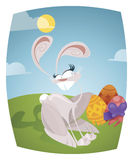 Easter bunny. And colorful eggs outdoor on a sunny day Stock Photography