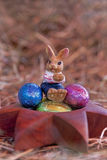 Easter bunny. An Easter bunny with Easter eggs in a nest of straw Stock Photography