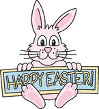Easter Bunny. Cute pink bunny holds a \Happy Easter\ sign Stock Photo