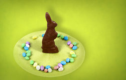 Easter Bunny. Chocolate easter bunny standing amongst some easter eggs royalty free stock photography