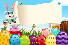 Easter Bunny. A vector illustration of an Easter bunny holding a blank sign surrounded by Easter eggs vector illustration