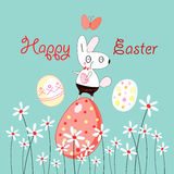 Easter Bunny. Funny Easter Bunny on a blue background with flowers and eggs Royalty Free Stock Photos