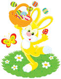 Easter Bunny. Vector clip-art of Easter Bunny dancing with a basket filled with colored eggs Royalty Free Stock Images