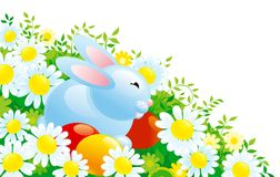 Easter bunny. Cute easter bunny  and eggs on  green grass with many spring flowers Royalty Free Stock Image