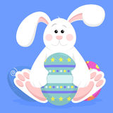 Easter Bunny. An illustration of a cute easter bunny with some easter eggs. Background placed on separate layer vector illustration