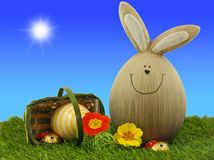 Easter Bunny. With Easter Eggs And Primroses And Ladybugs On Green Grass With Blue Sky And Sun In Background Stock Images