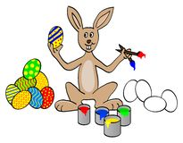 Easter bunny. Painting easter eggs Royalty Free Stock Photos