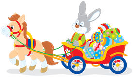 Easter bunny. Rabbit carrying Easter eggs in a cart with a pony Royalty Free Stock Photography