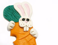 Easter bunny. Close-up of Easter bunny with carrot Royalty Free Stock Photography