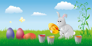 Easter bunny. With colourful eggs on the spring meadow Royalty Free Stock Image