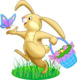 Easter Bunny. Illustration of rabbit with a basket full of eggs and butterfly Royalty Free Stock Image