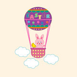 An Easter bunny on the air-balloon. An Easter bunny and a cute chick on the colorful air-balloon Stock Photo