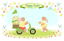 Easter bunny as scooter delivery of big easter egg Stock Photos