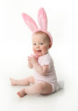 Easter bunny baby. Portrait of a cute baby dressed in Easter bunny ears pastel eggs Stock Images