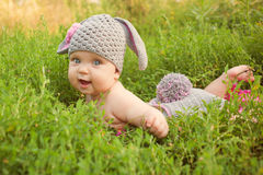 Easter bunny baby in green meadow. Stock Images