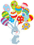 Easter Bunny with balloons. Little rabbit with colorful balloons decorated like Easter eggs Royalty Free Stock Photography