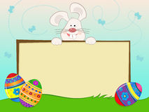 Easter Bunny Banner. Cute Easter bunny with banner, Easter eggs and decorative background. Eps10 Stock Image