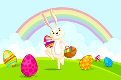 Easter bunny with basket colorful egg Royalty Free Stock Photography