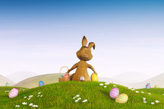 Easter bunny with a basket and Easter eggs Royalty Free Stock Photo