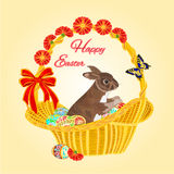 Easter bunny in a basket with Easter eggs vector Royalty Free Stock Image