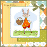 Easter bunny with a basket of Easter eggs Stock Photography