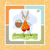 Easter bunny with a basket of Easter eggs Royalty Free Stock Image