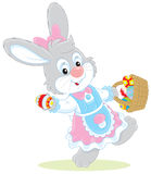 Easter Bunny with a basket of eggs Stock Photography