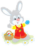 Easter Bunny with a basket of eggs Royalty Free Stock Photo