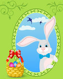 Easter bunny. And basket full of colored eggs Royalty Free Stock Photography