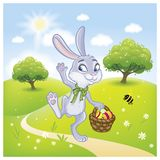 The Easter bunny with a basket full of painted Easter eggs.  Royalty Free Stock Photography