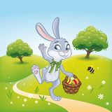 The Easter bunny with a basket full of painted Easter eggs.  Stock Image