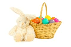 Easter bunny and basket over white Royalty Free Stock Images