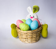 Easter bunny with a basket with painted colorful eggs Stock Photo