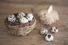 Easter bunny with basket of quail eggs Royalty Free Stock Photos