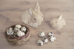 Easter bunny with basket of quail eggs Stock Photography