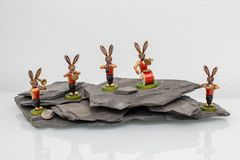 A easter bunny big band play musik on a rock. Figures of easter bunnies big band play musik on a rock Royalty Free Stock Photo