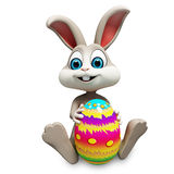 Easter bunny with big color egg Stock Image