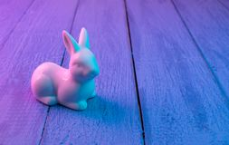 Easter bunny on a blue wooden background stock image