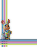 Easter Bunny Border or Frame. Image and illustration composition of Ceramic Bunny boy in patchwork costume standing on picture frame for Easter background or Royalty Free Stock Photos