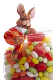 Easter bunny with bowl of sugar eggs Royalty Free Stock Images