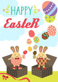 Easter bunny box. Happy easter bunnies standing in unwrapped present boxes conjuring easter eggs Stock Photo