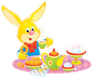 Easter Bunny at breakfast. Clip-art / illustration with funny character for your design Royalty Free Stock Photos