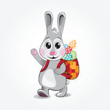 Easter Bunny brings colored eggs. Vector illustration. Stock Photos
