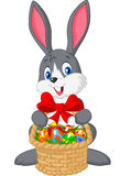 Easter bunny with bucket of eggs Royalty Free Stock Photos