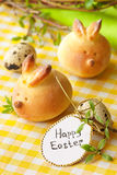 Easter bunny buns. Sweet Easter bunny buns and quail eggs Royalty Free Stock Images