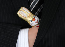 Easter Bunny in businessman's pocket Stock Photos